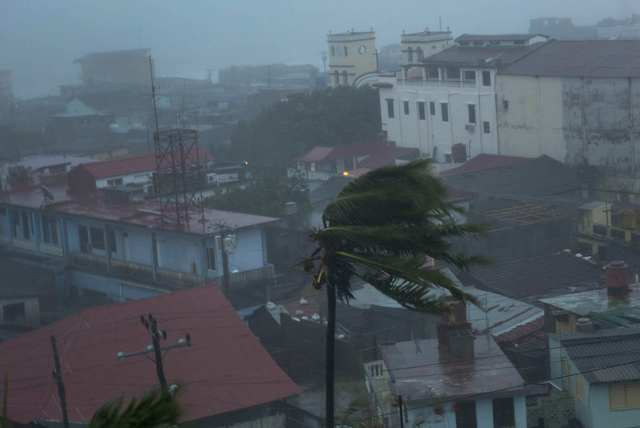 The high winds of Hurricane Matthew roar over Baracoa, Cuba, Tuesday, Oct. 4, 2016. The dangerous Category 4 storm blew ashore in Haiti, unloading heavy rain as it swirled on toward a lightly popu ...