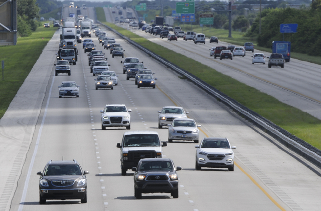 Northbound traffic on Interstate 95 flows northbound through Viera, Florida, as beachside residents evacuate in advance of Hurricane Matthew, Wednesday, Oct. 5, 2016. Most of the counties along Fl ...