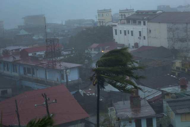 The high winds of Hurricane Matthew roar over Baracoa, Cuba, Tuesday, Oct. 4, 2016. The dangerous Category 4 storm blew ashore in Haiti, unloading heavy rain as it swirled on toward a lightly popu ...