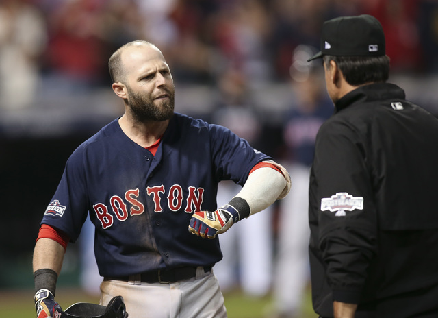 Boston Red Sox's Dustin Pedroia talks about a third strike on a checked swing with first base umpire Phil Cuzzi, during the ninth inning against the Cleveland Indians in Game 1 of baseball's Ameri ...