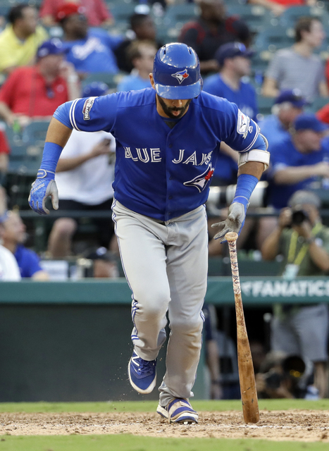 Toronto Blue Jays' Jose Bautista drops his bat after hitting a three-run home run off of Texas Rangers' Jake Diekman during the ninth inning of Game 1 of baseball's American League Division Series ...