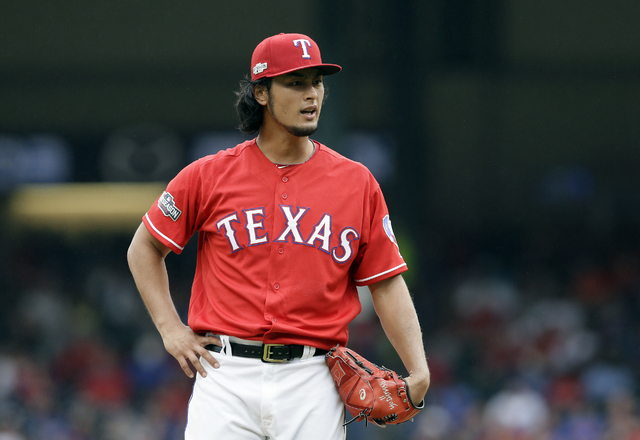 Texas Rangers pitcher Yu Darvish, of Japan, stands on the mound after giving up a solo home run to Toronto Blue Jays' Kevin Pillar in the fifth inning of Game 2 of baseball's American League Divis ...