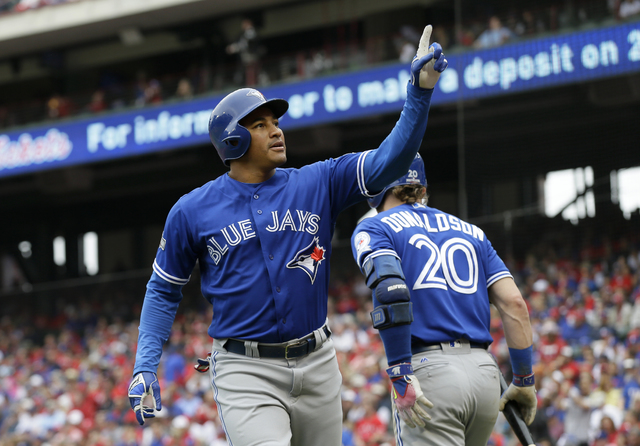 Toronto Blue Jays' Ezequiel Carrera (3) celebrates his solo home run in the fifth inning of Game 2 of baseball's American League Division Series against the Texas Rangers, Friday, Oct. 7, 2016, in ...