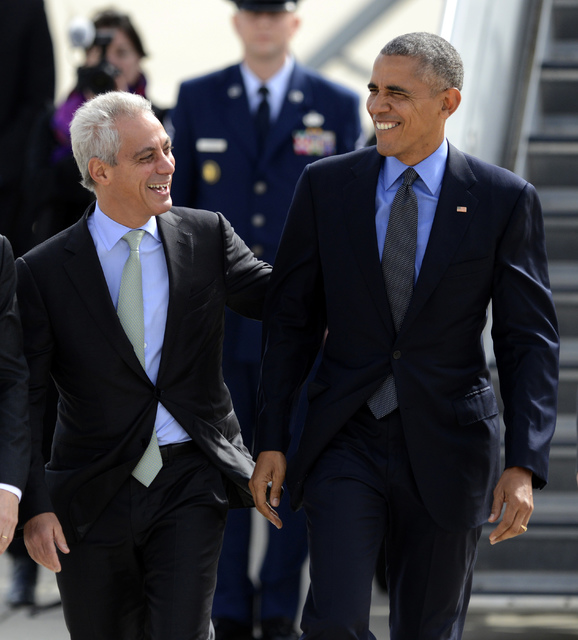 President Barack Obama right, talks with Chicago Mayor Rahm Emanuel left, after walking off Air Force One while arriving at O'Hare International Airport Friday, Oct. 7, 2016, in Chicago. (Paul Bea ...