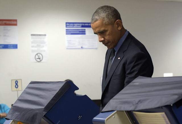President Barack Obama votes at the Chicago Board of Elections in Chicago, Friday, Oct. 7, 2016. Obama is spending the weekend in Chicago. (Susan Walsh/AP)