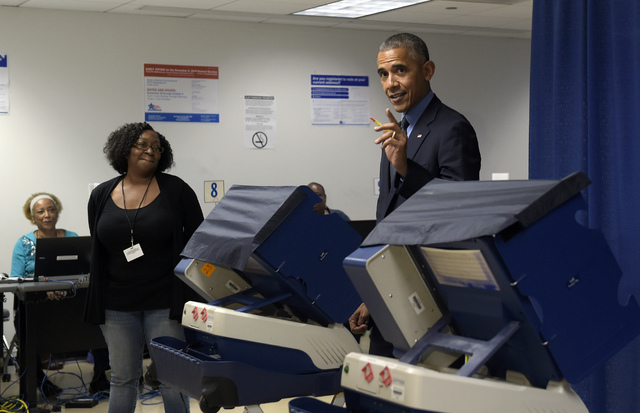 President Barack Obama cast his ballot at the Cook County Office Building in Chicago, Friday, Oct. 7, 2016. Obama is spending the weekend in Chicago. (Susan Walsh/AP)