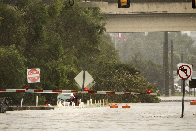 An unidentified woman is rescued from her vehicle which is floating in waist-deep water on flooded President Street after Hurricane Matthew caused flooding along the east coast of Georgia, Saturda ...
