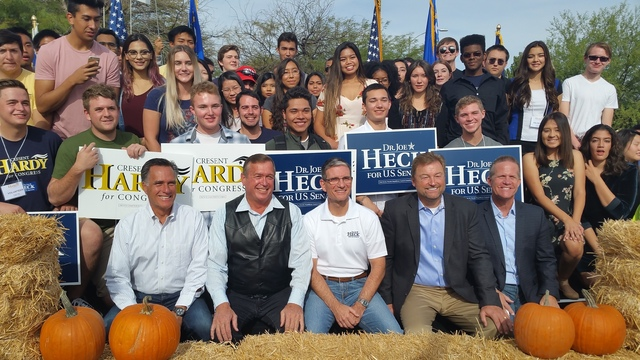 Mitt Romney, Rep. Cresent Hardy, Rep. Joe Heck, Sen. Dean Heller and Nevada Lt. Gov. Mark Hutchison pose for photos with campaign volunteers at a campaign rally in Las Vegas on Saturday, Oct. 8, 2 ...