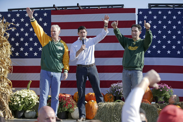 "From left, U.S. Sen. Ron Johnson, House Speaker Paul Ryan and Gov. Scott Walker, acknowledge the crowd after they spoke at the ""Fall Fest"" Wisconsin Republican unity rally at the ..."