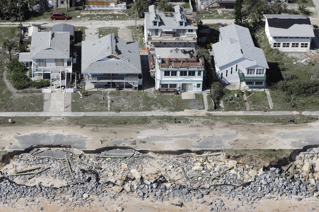 In this aerial photo, portions of SR A1A are washed out from Hurricane Matthew, Saturday, Oct. 8, 2016, in Flagler Beach, Fla.  The damage from Matthew caused  beach erosion, washed out some roads ...