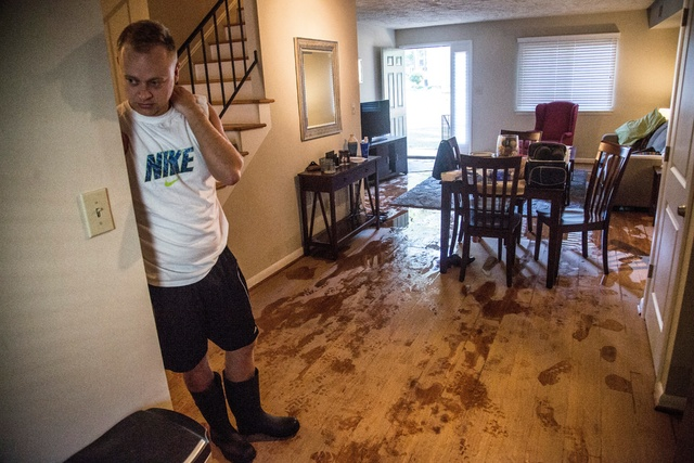 Jeremy Spearman checks on flood damage to his Parkside Five Points Townhomes apartment in Raleigh, N.C., after Hurricane Matthew caused downed trees and flooding Sunday, Oct. 9, 2016. (Travis Long ...