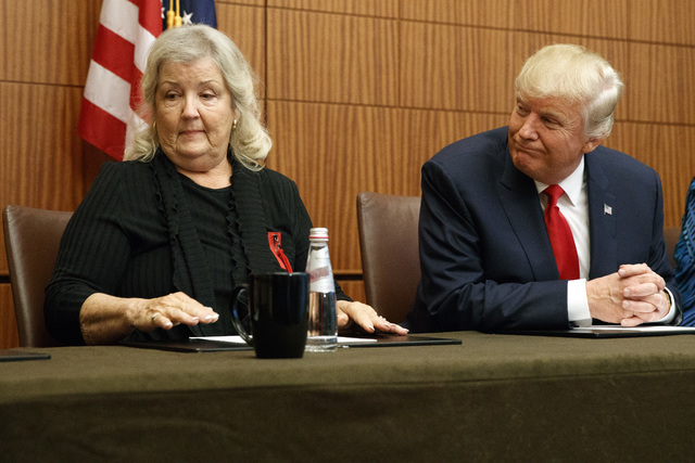 Republican presidential candidate Donald Trump looks on as Juanita Broaddrick, who has accused former President Bill Clinton of sexual assault, speaks before the second presidential debate against ...