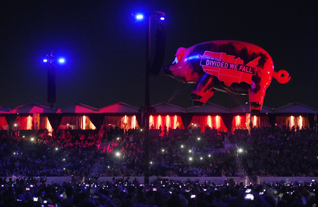 An inflatable pig flies above the crowd during Roger Waters' closing performance on Day 3 of the 2016 Desert Trip music festival at Empire Polo Field on Sunday, Oct. 9, 2016, in Indio, California. ...