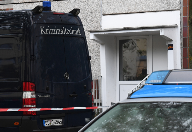 A police barrier tape and a vehicle of a forensic team blocks off the entrance to an apartment in the Paunsdorf district of Leipzig, Germany, Monday, Oct. 10, 2016. Two days after explosives were  ...