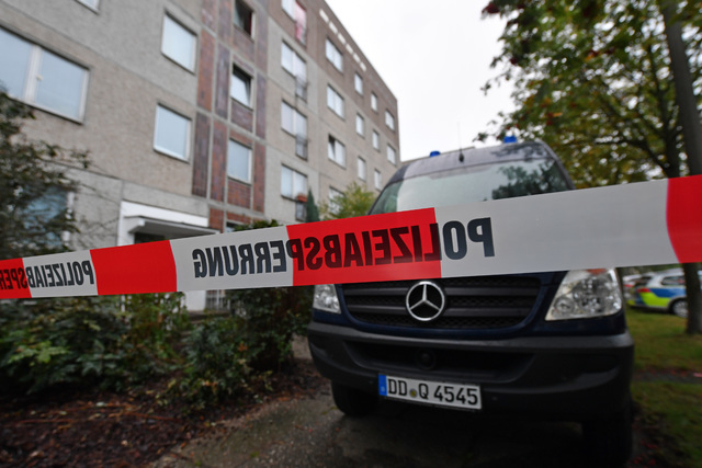 A German terror suspect was arrested on Monday after three Syrians recognized the suspect from a police wanted poster in Leipzig, Germany (Hendrik Schmidt/AP)
