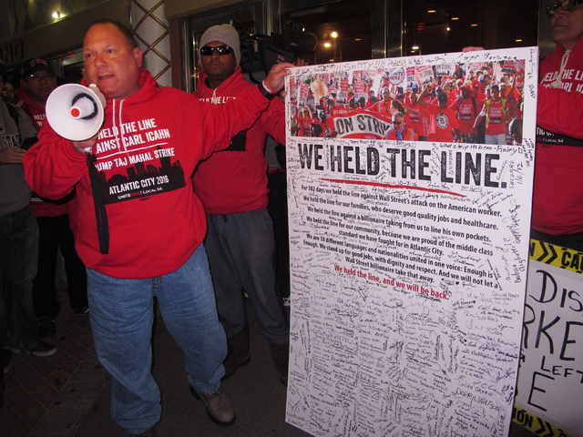 Marc Scittina, a players' club worker at the Trump Taj Mahal casino in Atlantic City, N.J., since shortly after it opened in 1990, addresses strikers who signed a poster critical of billionaire Ca ...