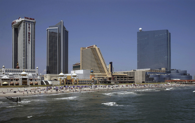 The Revel Casino Hotel, right, stands along the Boardwalk near Trump Taj Mahal Casino, left, with its Chairman Tower, and the Showboat Casino Hotel, second right, in Atlantic City, N.J., July 23,  ...