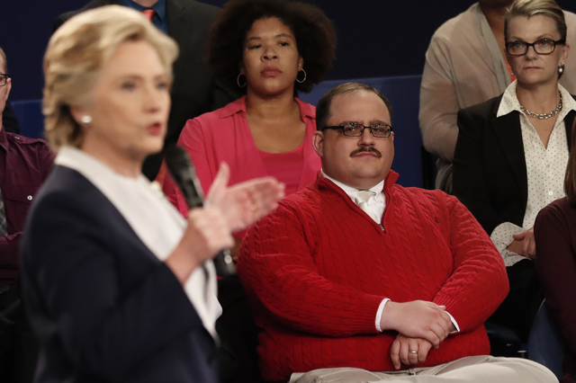 Kenneth Bone listens as Democratic presidential nominee Hillary Clinton answers a question during the second presidential debate with Republican presidential nominee Donald Trump at Washington Uni ...