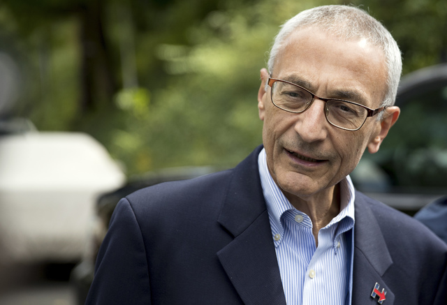 In this Oct. 5, 2016, photo, Hillary Clinton campaign chairman John Podesta speaks to members of the media outside Clinton's home in Washington. The WikiLeaks organization on Oct. 7, posted what i ...