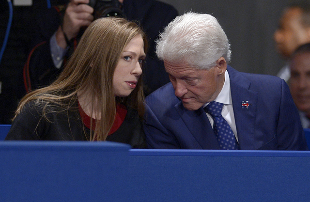 Chelsea Clinton, daughter of Hillary Clinton, talks to former President Bill Clinton during the second presidential debate between Republican presidential nominee Donald Trump and Democratic presi ...
