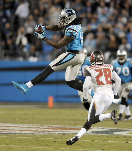 Carolina Panthers' Kelvin Benjamin (13) catches a pass against Tampa Bay Buccaneers' Vernon Hargreaves (28) in the first half of an NFL football game in Charlotte, N.C., Monday, Oct. 10, 2016. (AP ...