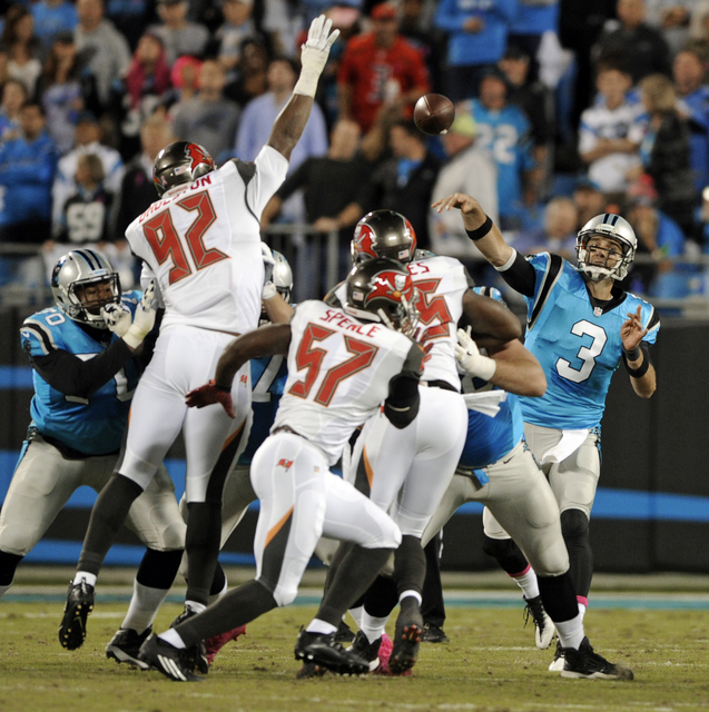 Carolina Panthers' Derek Anderson (3) throws a pass over Tampa Bay Buccaneers' William Gholston (92) in the first half of an NFL football game in Charlotte, N.C., Monday, Oct. 10, 2016. (AP Photo/ ...