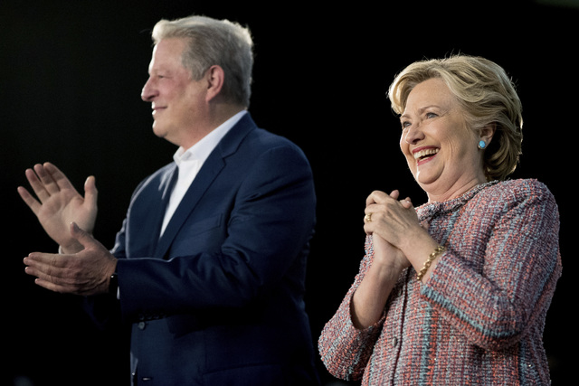 Democratic presidential candidate Hillary Clinton accompanied by former Vice President Al Gore takes the stage for a rally at Miami Dade College in Miami, Tuesday, Oct. 11, 2016. (Andrew Harnik/AP)