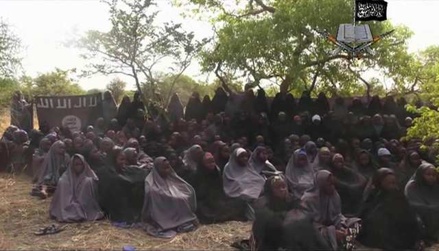 An image taken from video by Nigeria's Boko Haram terrorist network on May 12, 2014, shows girls presumed to have been abducted from the northeastern town of Chibok. (AP)