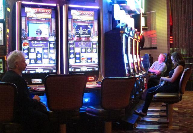 Gamblers sit at slot machines at the Golden Nugget casino in Atlantic City, N.J., June 24, 2016. (Wayne Parry/AP)