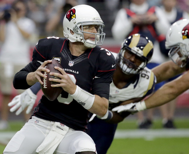 FILE - In this Sunday, Oct. 2, 2016, file photo, Arizona Cardinals quarterback Carson Palmer (3) looks to throw against the Los Angeles Rams during the first half of an NFL football game in Glenda ...