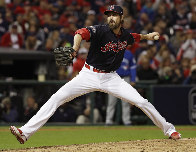 Cleveland Indians relief pitcher Andrew Miller throws against the Toronto Blue Jays during the seventh inning in Game 1 of baseball's American League Championship Series in Cleveland, Friday, Oct. ...