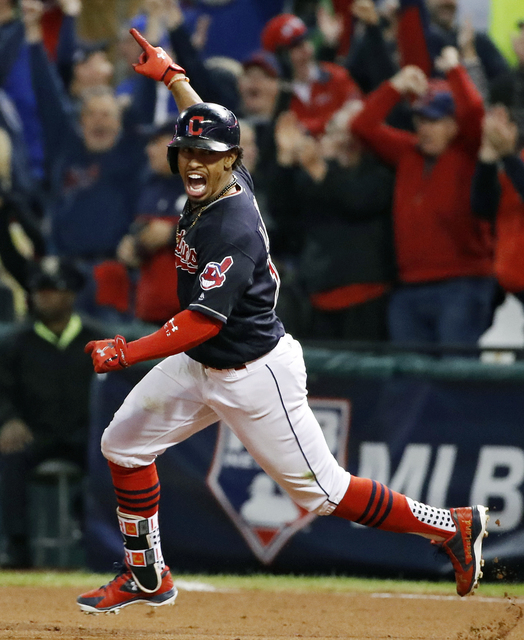 Cleveland Indians' Francisco Lindor celebrates after his two-run home run against the Toronto Blue Jays during the sixth inning in Game 1 of baseball's American League Championship Series in Cleve ...