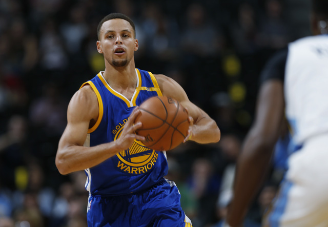 Golden State Warriors guard Stephen Curry passes the ball on a fast break against the Denver Nuggets in the first half of an NBA preseason basketball game Friday, Oct. 14, 2016, in Denver. (AP Pho ...