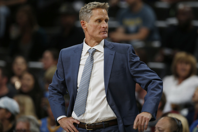 Golden State Warriors head coach Steve Kerr looks to the bench to call in a player to face the Denver Nuggets in the first half of an NBA preseason basketball game Friday, Oct. 14, 2016, in Denver ...