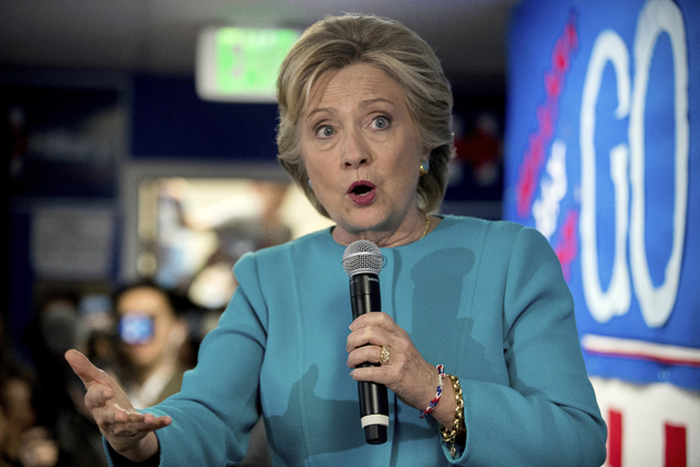 In this Oct. 14, 2016 file photo, Democratic presidential candidate Hillary Clinton speaks to volunteers at a campaign office in Seattle. Hillary Clinton has a tight grip on the Electoral College  ...