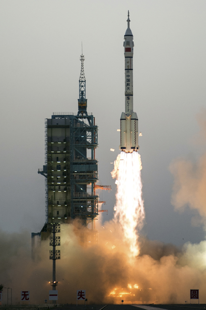 China's Shenzhou 11 spaceship onboard a Long March-2F carrier rocket takes off from the Jiuquan Satellite Launch Center in northwest China's Gansu province on Monday Oct. 17, 2016.  (Chinatopix vi ...