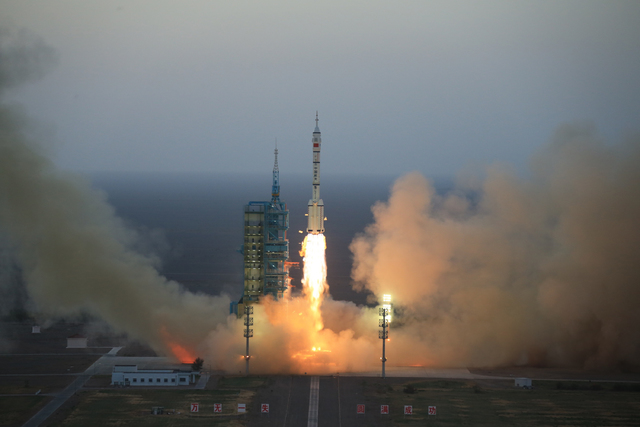 In this photo provided by China's Xinhua News Agency, the Long March-2F carrier rocket carrying China's Shenzhou 11 spacecraft blasts off from the launch pad at the Jiuquan Satellite Launch Center ...