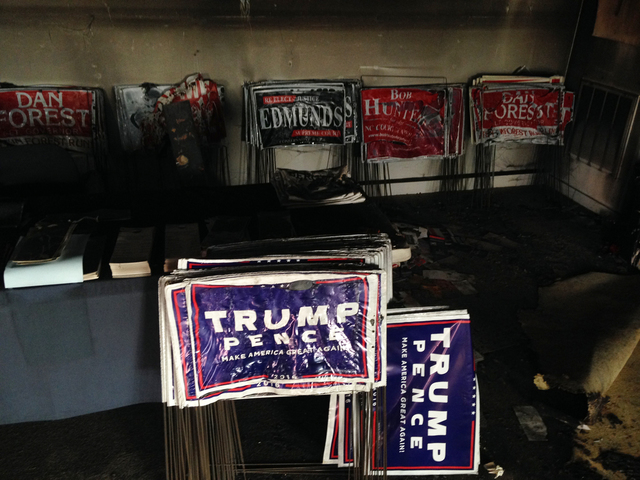 Melted campaign signs are seen at the Orange County Republican Headquarters in Hillsborough, NC on Sunday, Oct. 16, 2016. (AP Photo/Jonathan Drew)