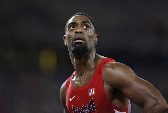 In this Aug. 23, 2015, file photo, Tyson Gay looks at his time from a men's 100-meter semifinal at the World Athletics Championships at the Bird's Nest stadium in Beijing. (David J. Phillip,/AP)
