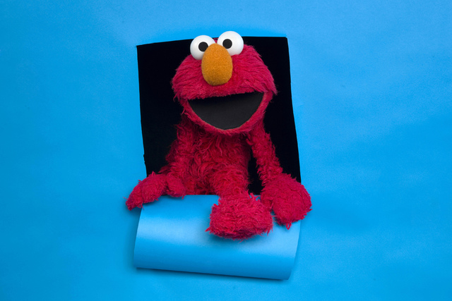 "FILE - In this Jan. 24, 2011, file photo, Elmo of the film ""Being Elmo"" poses for a portrait in the Fender Music Lodge during the 2011 Sundance Film Festival in Park City, Utah.  ..."