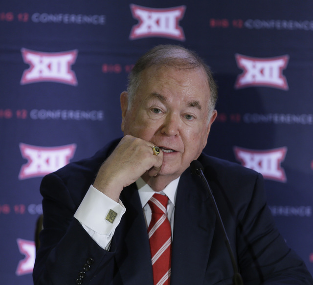 In this June 2, 2016, file photo, University of Oklahoma President David Boren speak to reporters after the second day of the Big 12 sports conference meetings in Irving, Texas. The Big 12 board o ...
