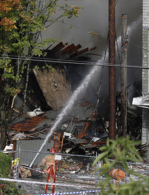 Firefighters battle a blaze after a gas explosion in Portland, Ore., Wednesday, Oct. 19, 2016. A powerful natural gas explosion that neighbors said felt like an earthquake rocked the busy a busy s ...