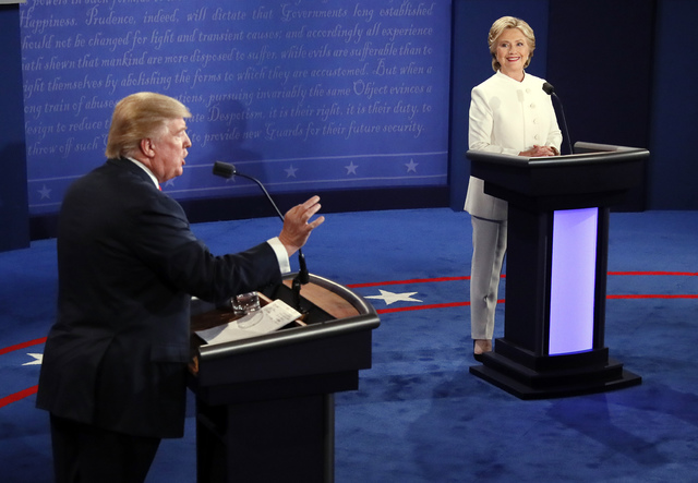 Republican presidential nominee Donald Trump debates Democratic presidential nominee Hillary Clinton during the third presidential debate at UNLV in Las Vegas, Wednesday, Oct. 19, 2016. (Mark Rals ...