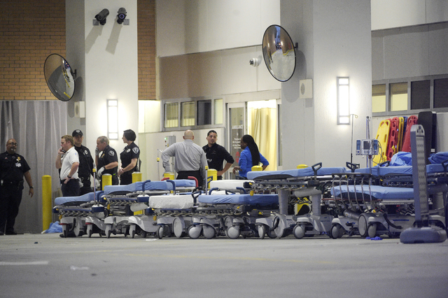 In this June 12, 2016, file photo,emergency personnel wait with stretchers at the emergency entrance to Orlando Regional Medical Center hospital for the arrival of patients from the scene of a fat ...