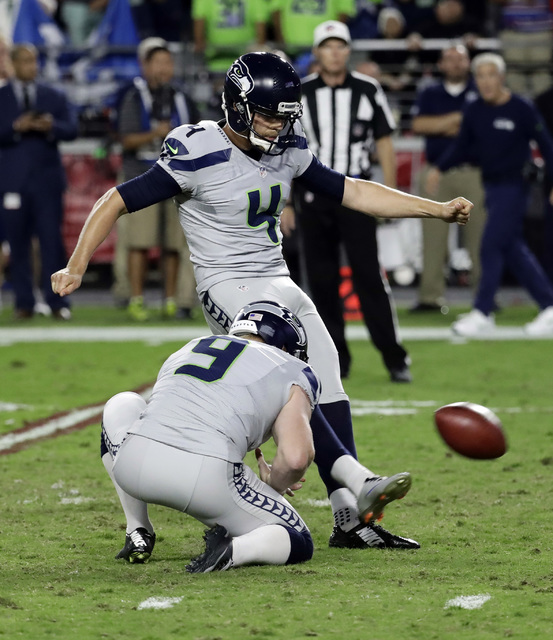 Seattle Seahawks kicker Stephen Hauschka (4) misses a game-winning field goal attempt as punter Jon Ryan (9) holds during overtime of an NFL football game against the Arizona Cardinals, Sunday, Oc ...
