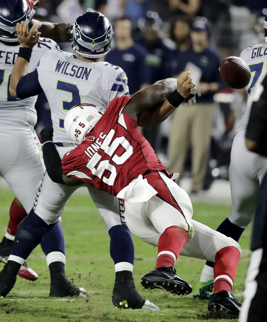 Seattle Seahawks quarterback Russell Wilson (3) has the football knocked loose for a fumble by Arizona Cardinals outside linebacker Chandler Jones (55) during the second half of a football game, S ...