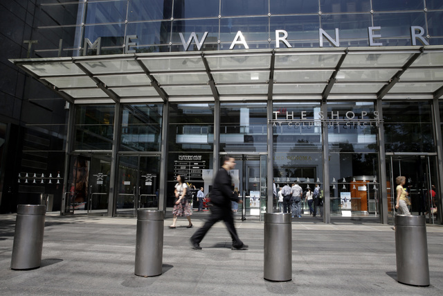 Pedestrians walk by an entrance to the Time Warner Center in New York City in 2015. (Mary Altaffer/AP)