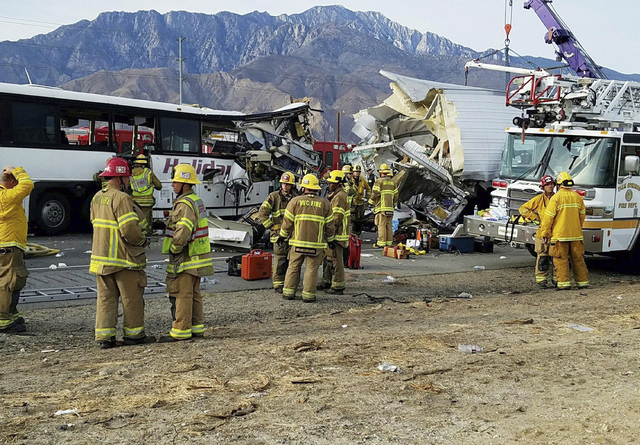 This photo provided by KMIR-TV shows the scene of crash between a tour bus and a semi-truck crashed on Interstate 10 near Desert Hot Springs, near Palm Springs, in California's Mojave Desert Sunda ...