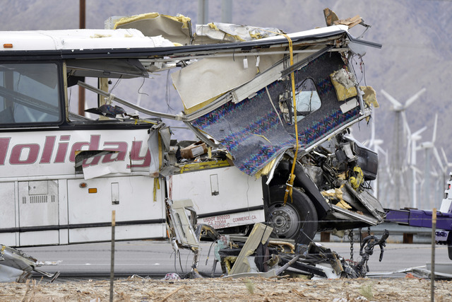At least 13 people and more than 30 were injured early Sunday when this tour bus and a semi collided on I-10 just north of Palm Springs, California. (Rodrigo Pena/AP)