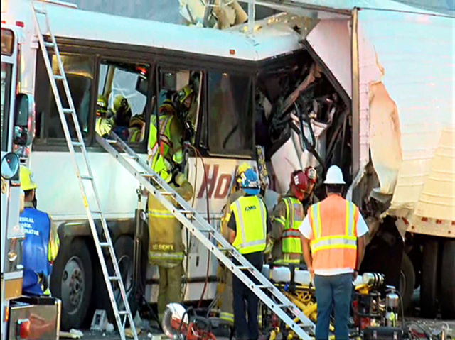 This photo provided by KESQ News Channel 3/CBS Local 2 shows the scene of crash between a tour bus and a semi-truck on Interstate 10 in Desert Hot Springs, near Palm Springs, in California's Mojav ...